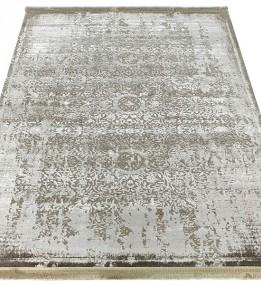 Синтетический ковер Nuans W1919 D.Beige-Ivory